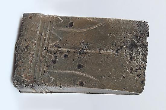 Бронзовый кельт, орнаментированный геометрическим узором. Тагарская культура. VII в. до н.э